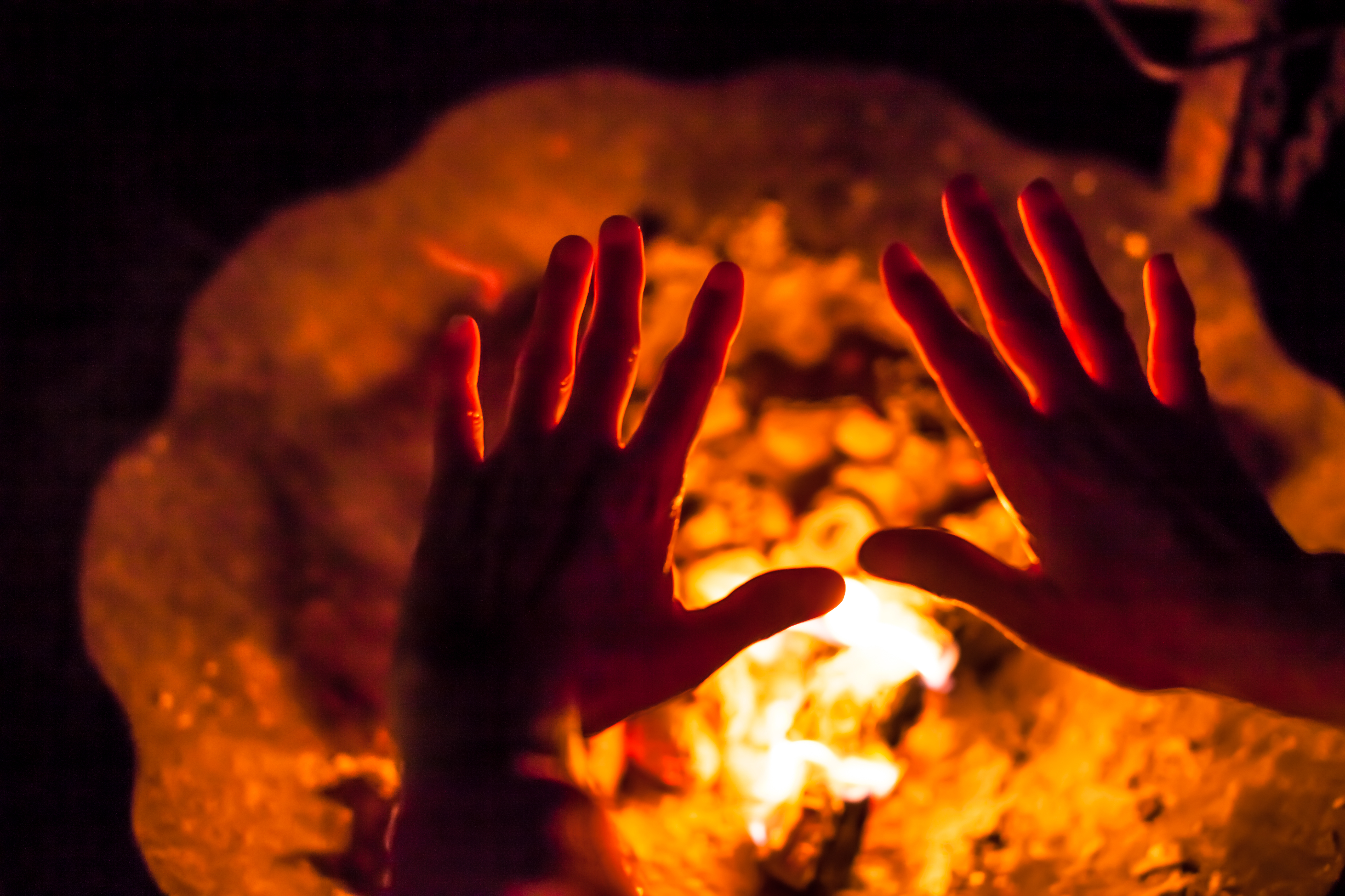 hands at fire